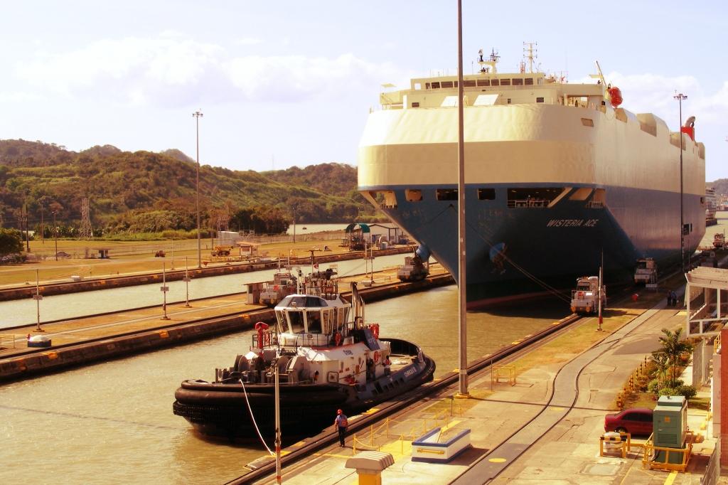 Tugboat and a Ship Panama Canal